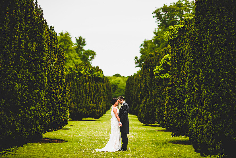 bride and groom in the gardens at Glemham Hall