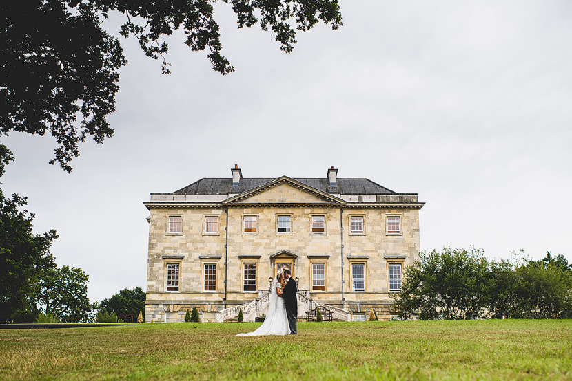 jade and oliver kissing wedding botleys mansion