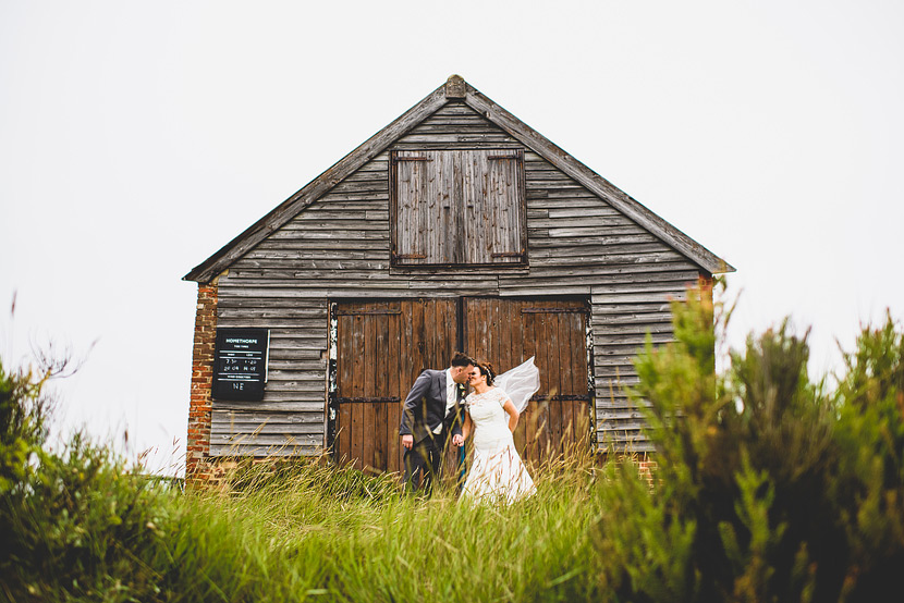 Titchwell Manor Wedding with Lee & Lizz kissing at the Coal Shed
