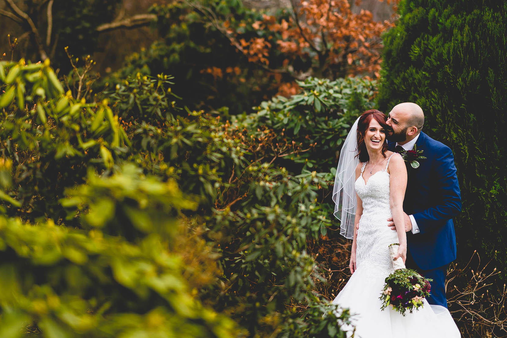 Marc and Helena having a cuddle in the garden at Rivervale barn wedding venue