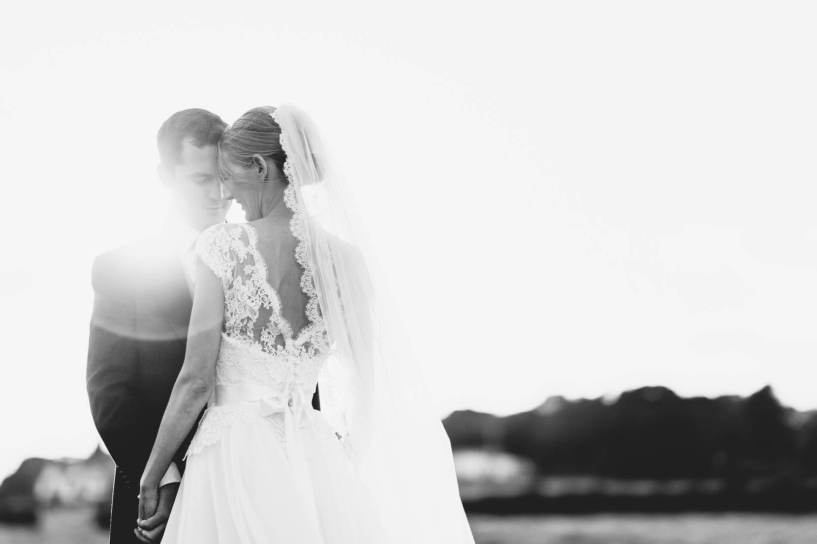derbyshire wedding photography with tom and lucy cuddling in golden light