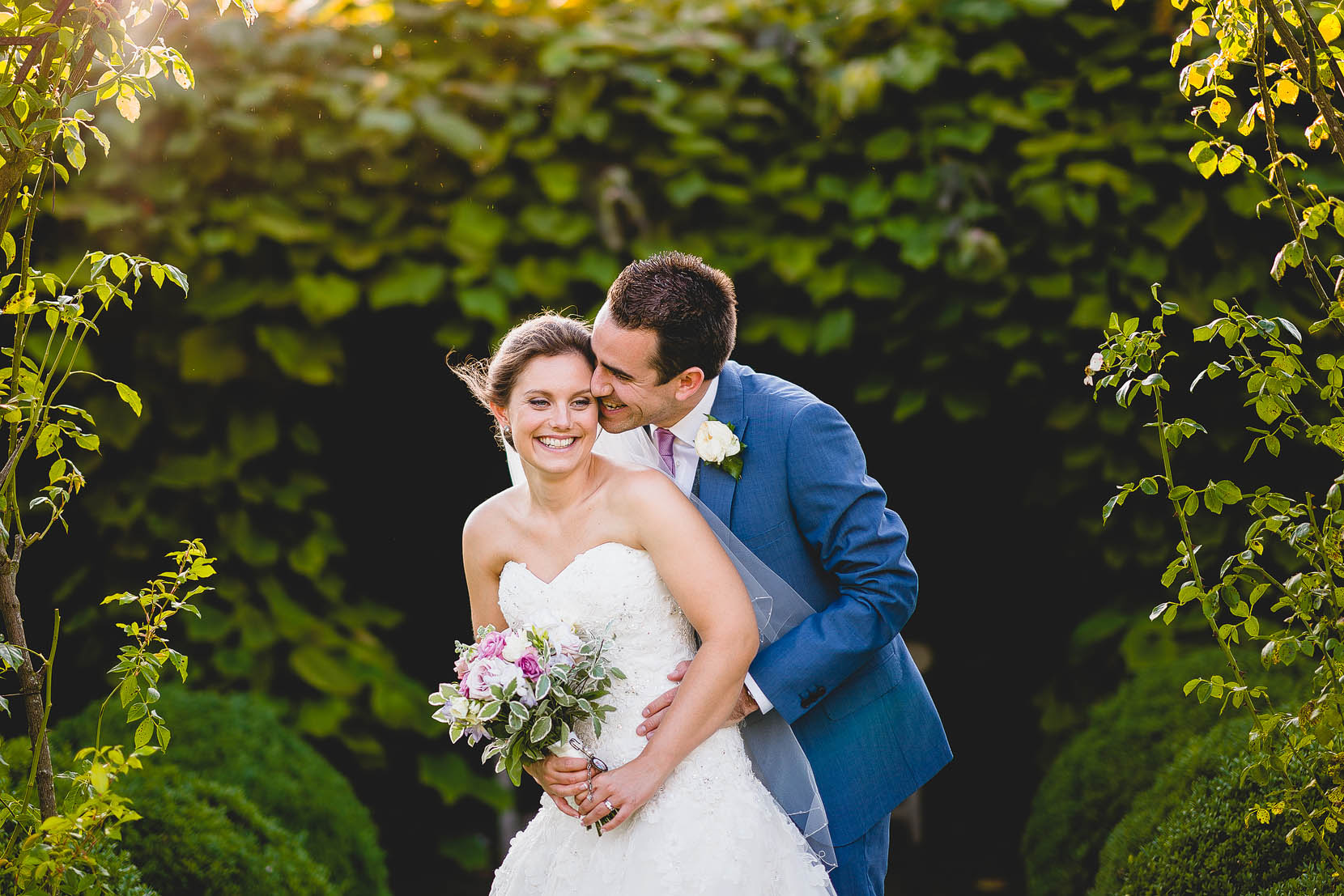 Elms barn bride and groom having a cuddle in some lovely evening light