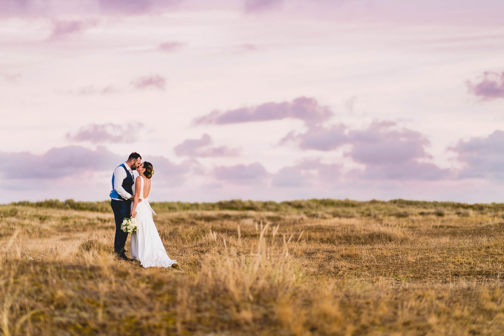 Great Yarmouth Wedding Photography, Katie & Rob on the beach having a snog in some golden evening light