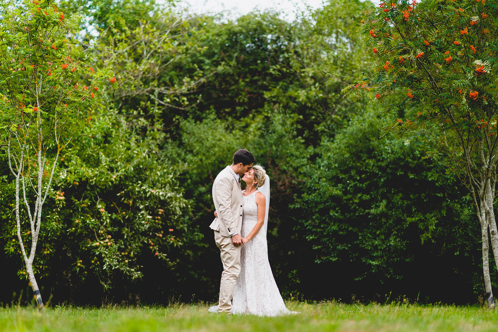 Tom and Jenny having a snuggle in mu and dads back garden in Swainsthorpe, Norfolk on their wedding day
