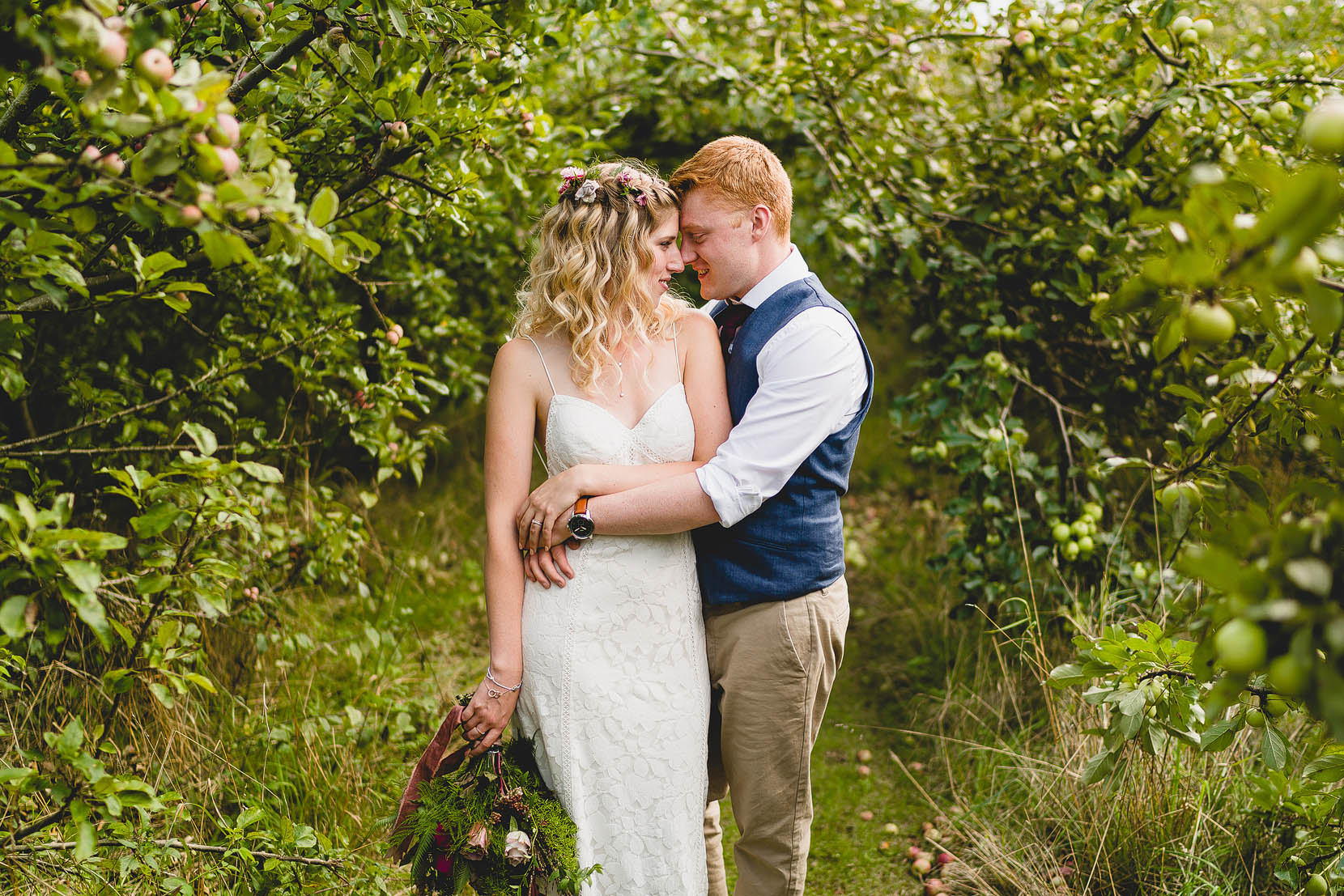 Ben and Shannah have a cuddle in golden light on their tipi relaxed wedding day