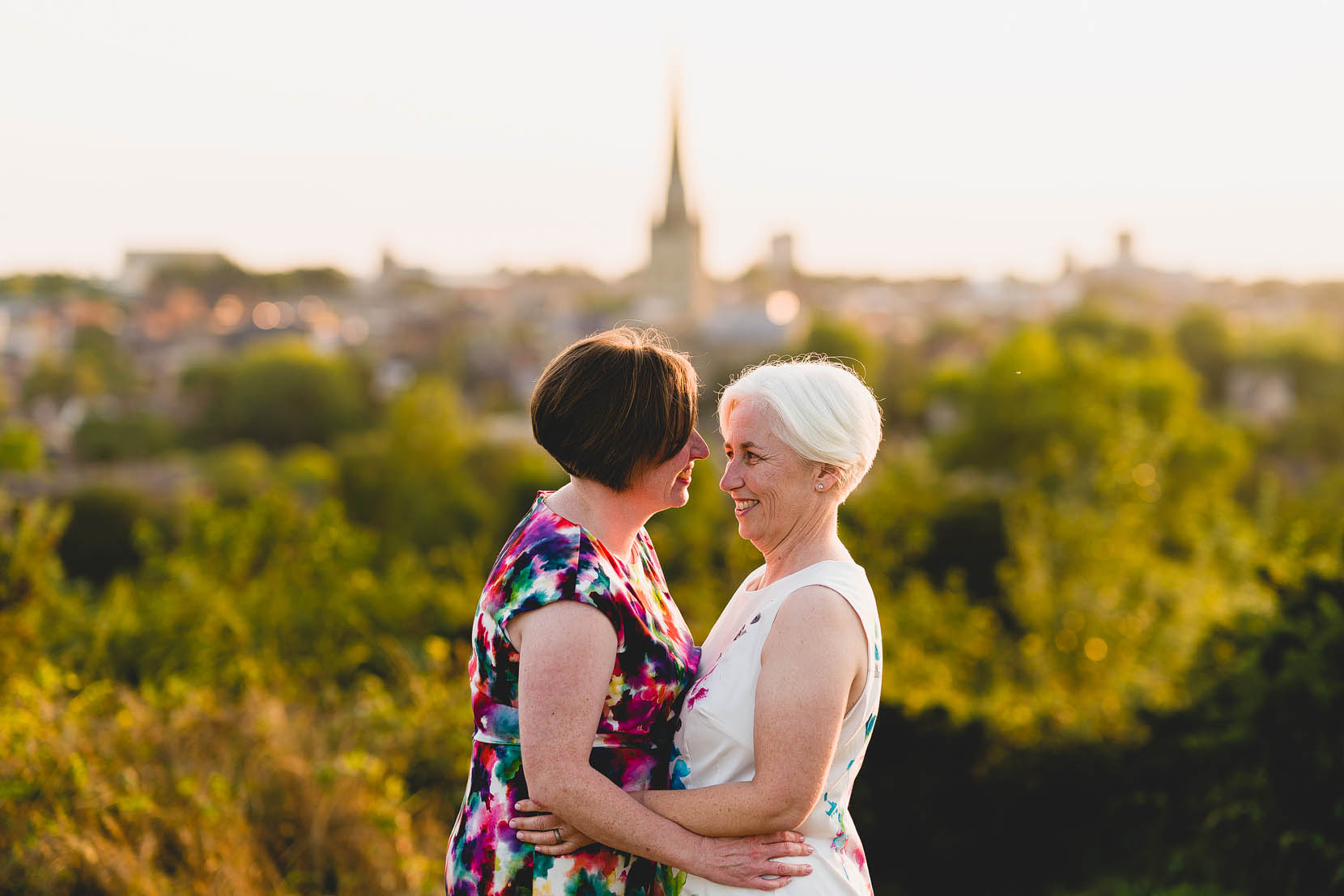 Amanda and Louise share a cuddle on top of Norwich, Norfolk after their same sex wedding