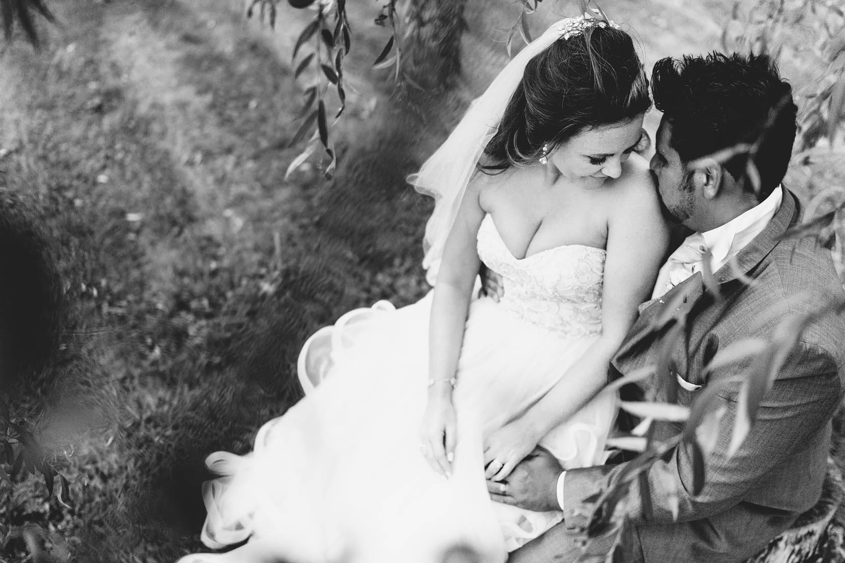 Marielle and Patrick snuggling on their wedding day at the Norfolk Mead Hotel in Coltishall Norfolk