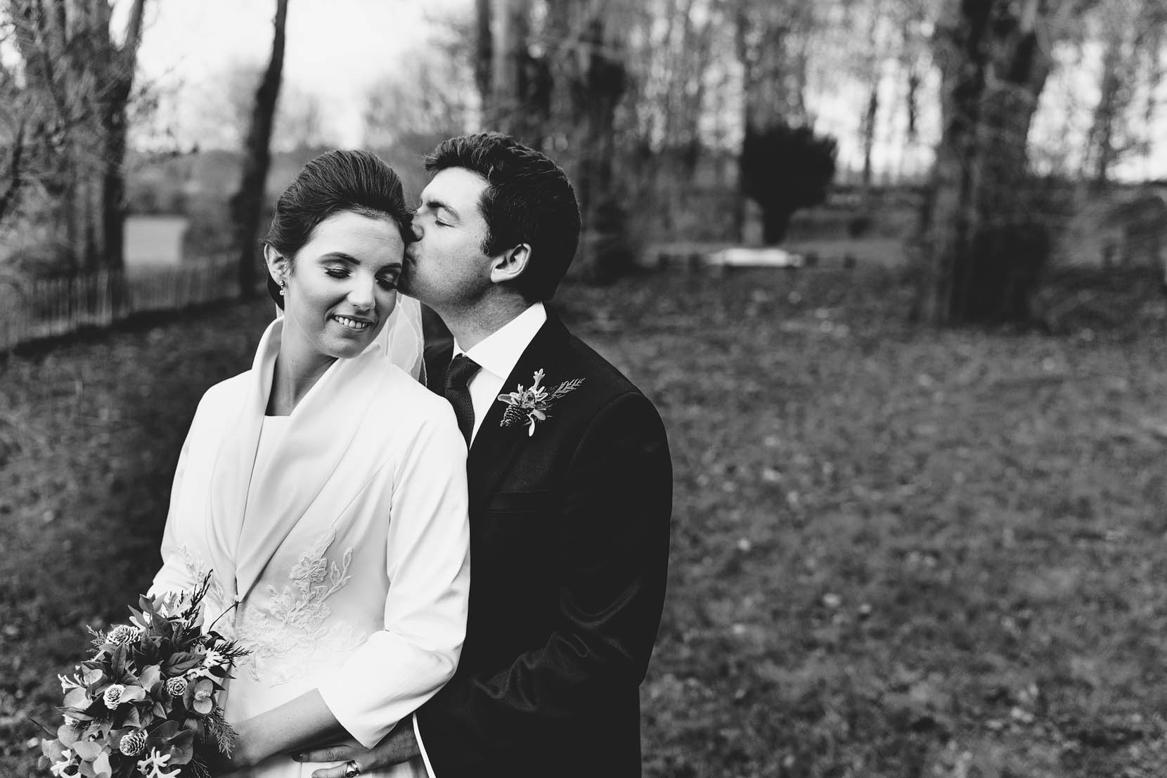norfolk wedding photgraphy for victoria and edward as they share a moment outside the church at Hardingham