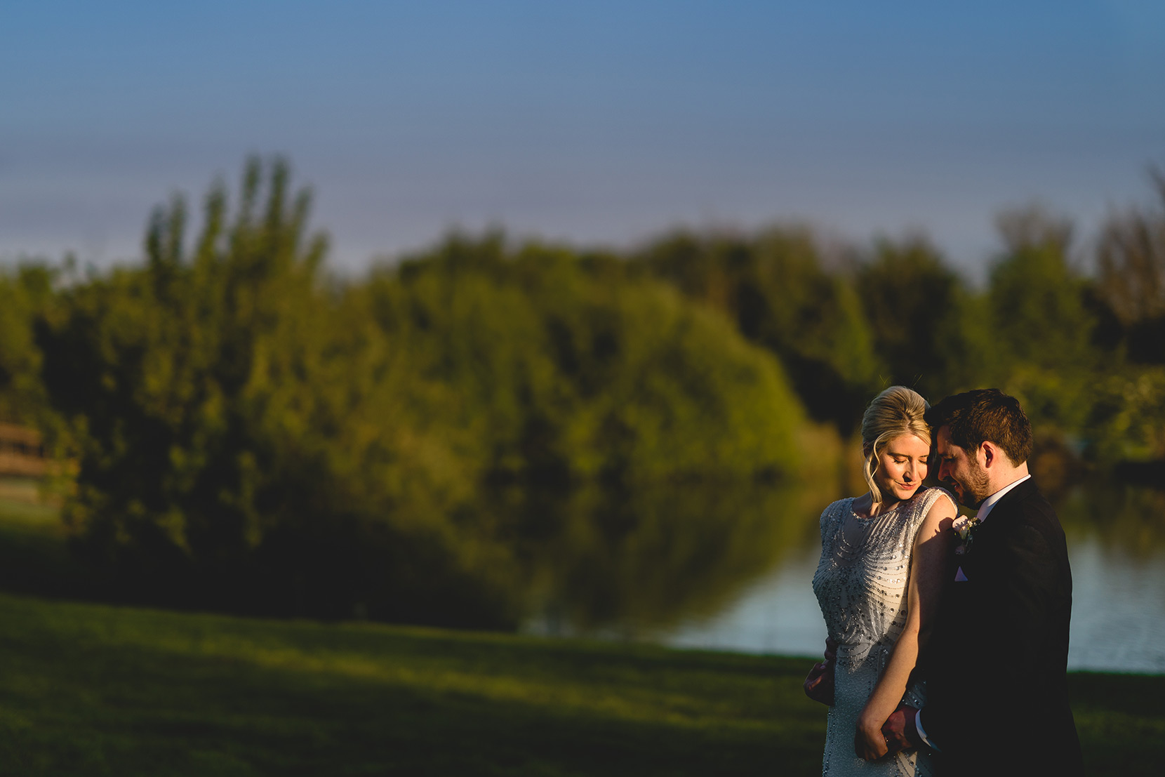 high house farm wedding photo with blair and shelley have a cuddle in gorgeous golden evening light